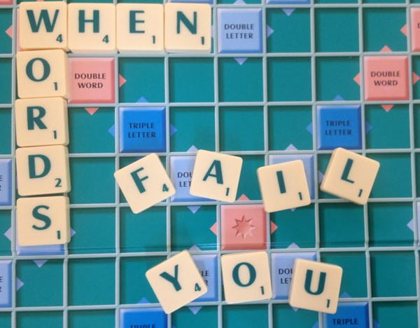 An image of a scrabble board and letter tiles that spell out