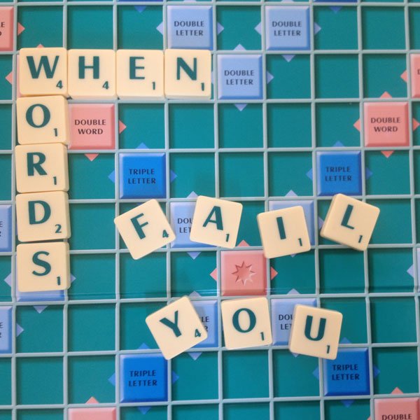 "An image of a scrabble board and letter tiles that spell out ""When words fail you"""