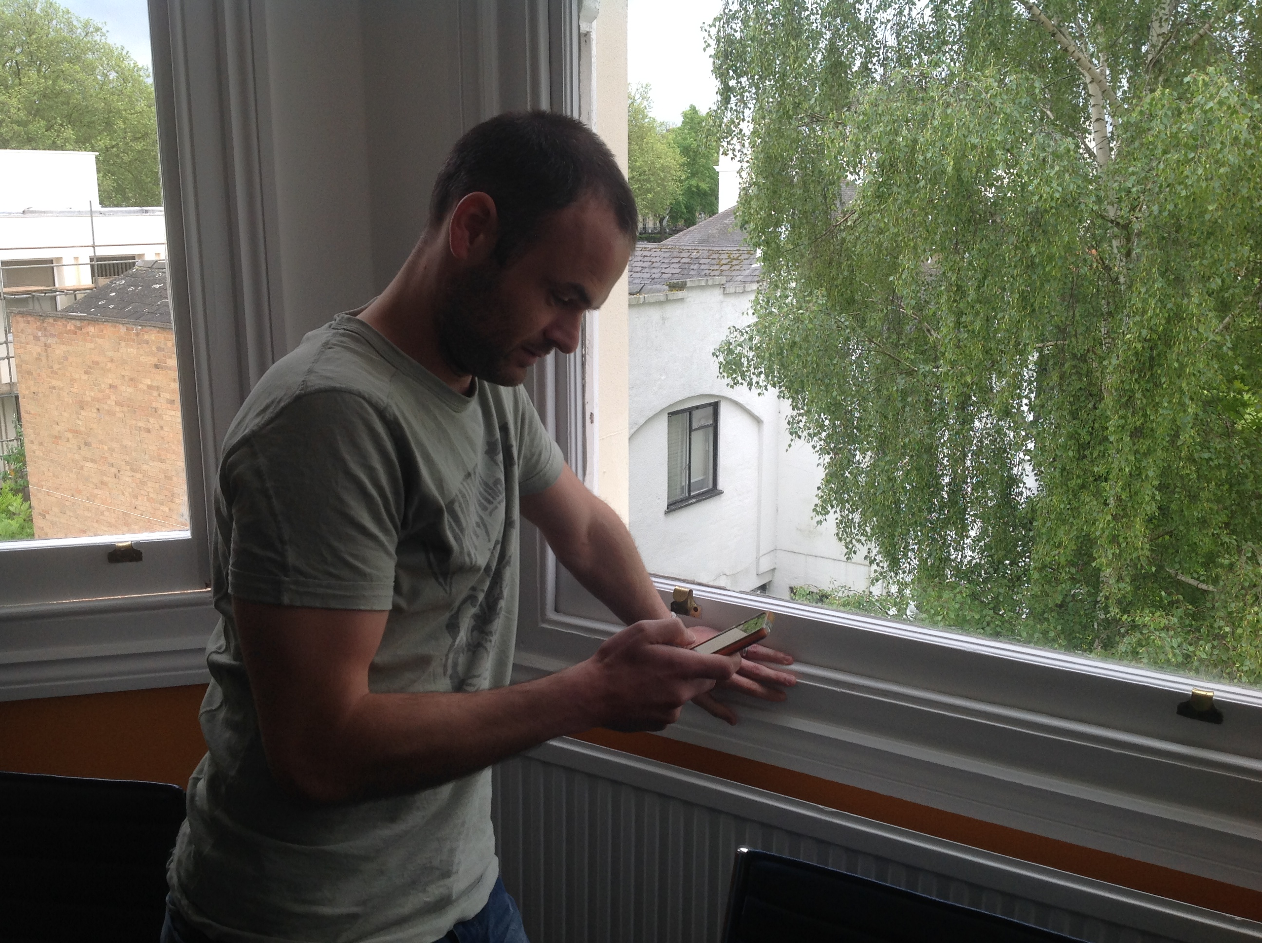 A photo of Mike Rice using his mobile first